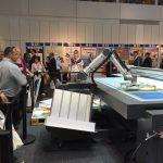 Rob, il Robot di swissQprint, da agli stampatori maggiore produttività